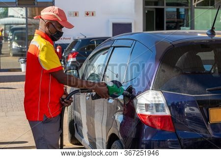 African petrol attendant at a gas station in Botswana