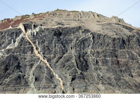 Geological Outcrops With The Exit Of Vein Formations To The Surface Of The Sea Coastline. View Of Th