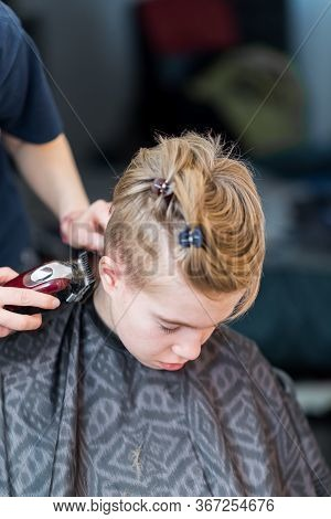 Mom Cuts The Hair Of Her Son At Home During Quarantine Amid Covid-19 \ncoronavirus Pandemic