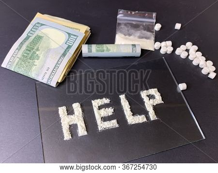 Pills, Us Dollar Banknotes And Cocaine  On A Gray Background. Stop Drugs Concept. A Word