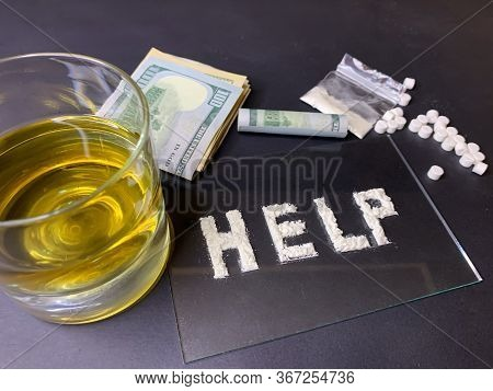Pills; Us Dollar Banknotes; Whiskey And Cocaine; On A Gray Background. Stop Drugs Concept. A Word \