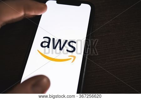 Amazon Web Services Logo On The Smartphone Screen. Copy Space.