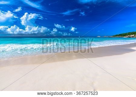 Turquoise Waters Of Grand Anse, La Digue, Seychelles. Grand Anse Beach Of Seychelles Islands With Co
