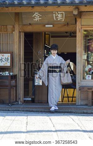 Kyoto, Japan - November, 8, 2019: Mature Japanese Female Wearing Traditional Silk Geisha\'s Kimono T
