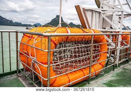 Orange Life Raft. Mesh At The Bottom Of The Raft. Thailands Warm Sea
