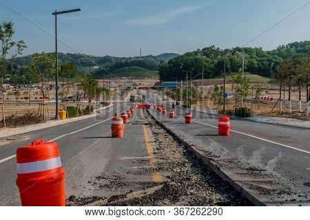 Daejeon, South Korea; May 17, 2020: Section Of Pavement In Middle Of Road Removed For Installation O