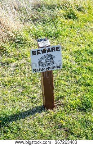Scotts Bluffs Nm, Ne, Usa - May 4, 2019: A Warning Sign In Case Of Rattlesnake Sighting
