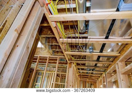 Framed Residential Home With Basic Rough Pipe System Of Heating Completed In New Construction