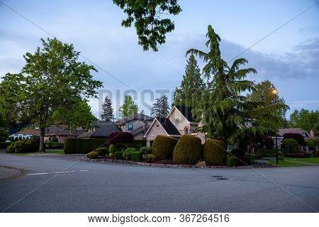 Residential Suburban Neighborhood In The City During A Vibrant Spring Sunset. Taken In Fraser Height