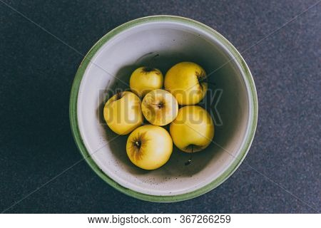 Plant-based Ingredients, Group Of Golden Delicious Apples In Bowl On Kitchen Countertop
