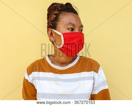 Photo Of A Asian Young Girl Wearing Face Mask For Prevent From Coronavirus During Lockdown With Sele
