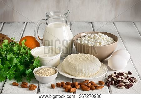 High Calcium Foods On A White Wooden Table. A Variety Of Products Rich In Calcium. Side View.
