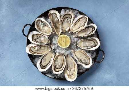 A Dozen Of Oysters On Ice, With A Lemon, Shot From The Top