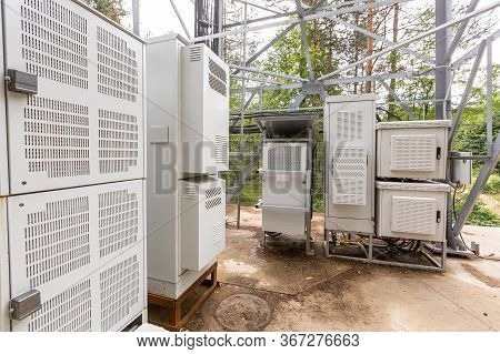 Climatic Vandal-proof Cabinets With Microwave Equipment And Power Cables, Coaxial Cables, Optic Fibe