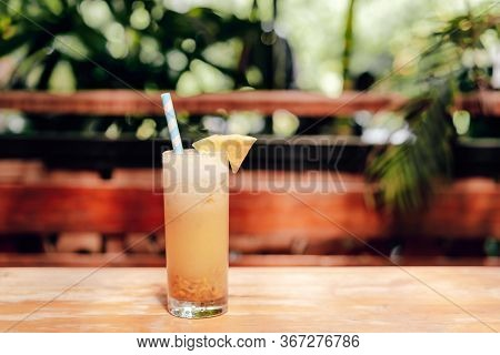Smoothies Of Pineapple On The Table With Green Background. Space For Text.
