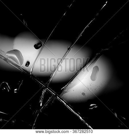 Broken Glass Background In Black. Black Minimalist Background With Cracks On The Glass With Water Dr