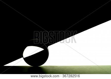 Glass Ball And With Black Geometric Shapes On White. Transparent Crystal Ball.