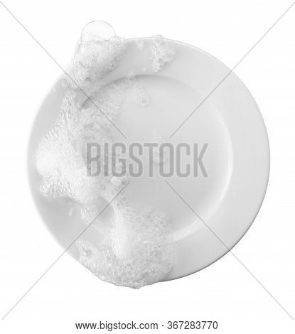 Soap And Bubble On Plate Representing Dishwashing