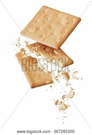 Broken Crackers With Crumbs Isolated On White