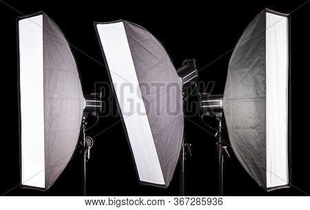 Set Of Photography Studio Flash With Softbox Isolated On Black Background.