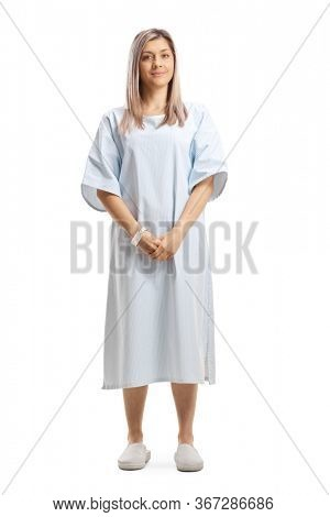 Full length portrait of a woman wearing a patient gown isolated on white background