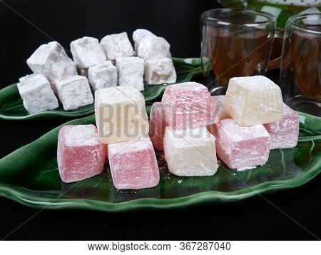 Turkish Delight On A Green Leaf Shaped Tray, On Dark Brown Background