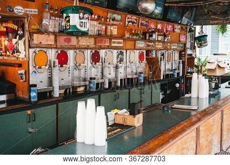 Key West, Florida, United States - July 11 2012: Bar Counter With Slush Machines In Flying Monkeys S
