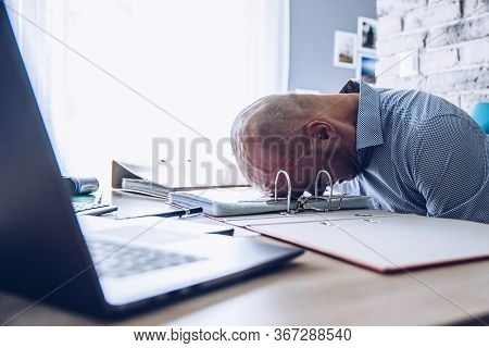 Crisis And Financial Problems . Stressed Man With Laptop Computer.