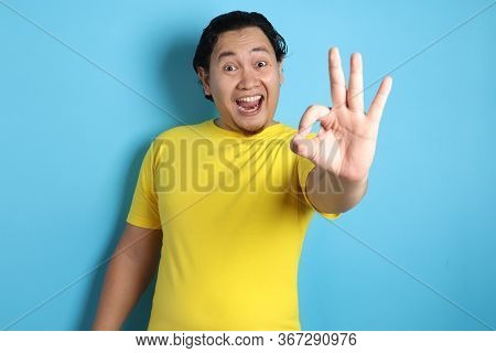 Young Man Showing Okay Gesture