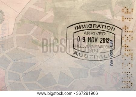 Immigration Control Arrival Stamp In The Passport Page. Immigration Australia. Travel Or Turism Conc
