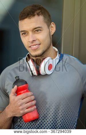 Young Latin Man Water Bottle Smiling Runner Portrait Format Running Sports Training Fitness