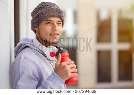 Sports Training Young Latin Man Drinking Water Looking Up Thinking Runner Copyspace Copy Space