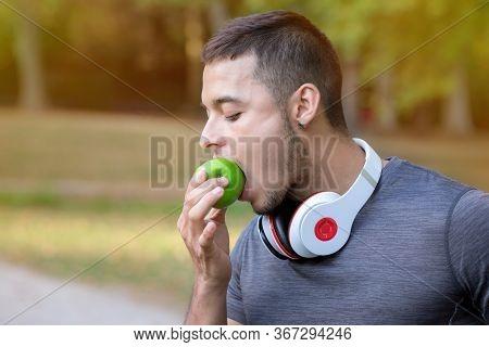 Runner Latin Man Eating Apple Running Jogging Sports Training Fitness Copyspace Copy Space