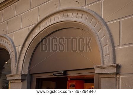 Building With A Showcase. Empty Plate In The Form Of An Arch On An Old House. Empty Space For A Numb