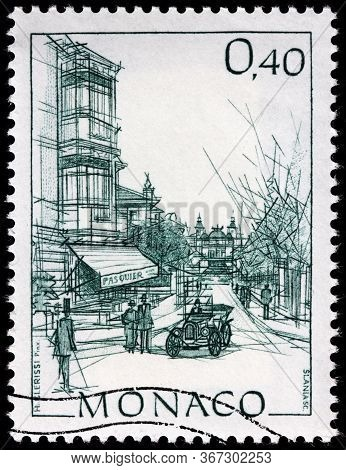 Luga, Russia - April 10, 2020: A Stamp Printed By Monaco Shows View Of The Rue Des Iris In Monte Car