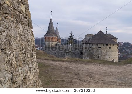 View Of The Kamyanets-podilsky Fortress From Behind The Stone Wall Of The Castle Fortifications