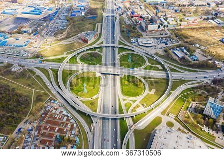 Top View Of The Multi-level Road Junction In Moscow From Above, Car Traffic And Many Cars, The Conce
