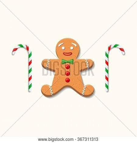 Cute Sweet Gingerbread Man With Green Bow Tie And Red Buttons Made Of Icing And Two Candy Canes On W