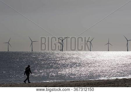 Beach Walk. Morning Coronavirus Covid19 Lockdown Isolation Exercise By Alternative Energy Offshore W