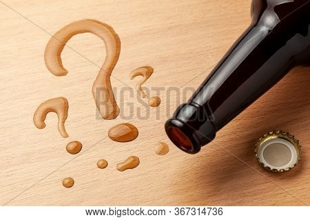 Beer Bottle And Question Marks. Kaka Choose Beer. Why Drink Alcohol