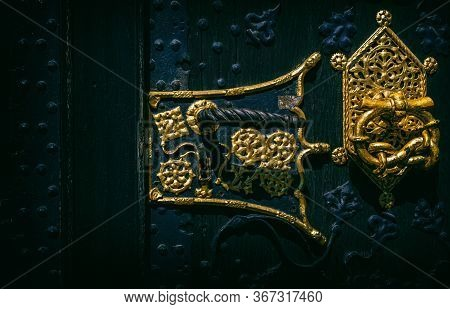 An Wooden Old Door With Golden Decoration
