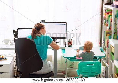 Mother With Kid Working From Home During Quarantine. Stay At Home, Work From Home Concept During Cor