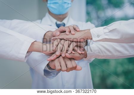 Doctors Join Hands Together,doctors And Nurses In A Medical Team Stacking Hands Stop Coronavirus-19