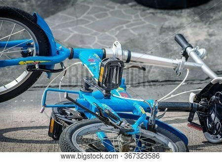 Bangkok, Thailand - May 21: Unnamed Brand Of Folding Bike Tipped Over On The Tarmac In The Nature Ci