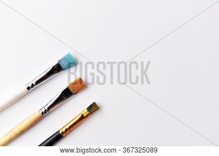 Art Brushes For Painting With Paints. On A White Background, There Is A Place For Text. The Brush Ha