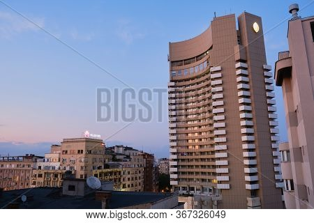 Intercontinental Hotel In Bucharest, Romania, At Sunset, Next To Old Buildings. Bucharest, Romania -