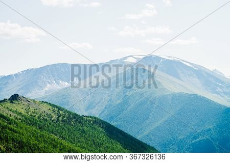 Beautiful Aerial View To Green Forest Hillside And Great Snowy Mountains. Awesome Minimalist Alpine
