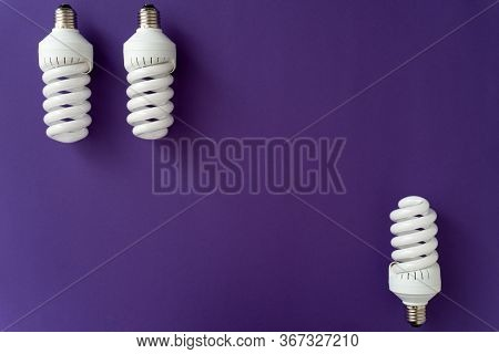 Two Halogen White Lamps On The Top Of Violet Background And One Halogen Lamp On The Bottom, Copy Spa