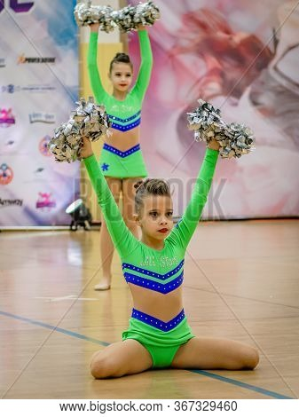 Moscow, Russia - December 22, 2019: Sport Performance Of Teenage Girls In Green Body Leotards With P