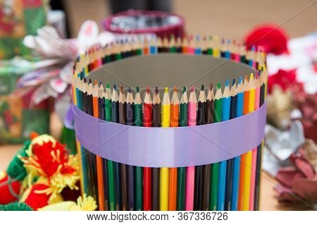 Colorful Colored Pencils On Blurred Bokeh Background . Colored Pencils Arranged In A Row And In A Ci
